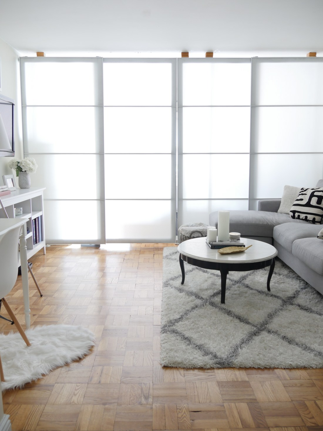 Live in a studio apartment and need to create a room divider? Need some studio apartment ideas? Learn how to here! #roomdivider #roomdividerideas #studioapartmentideas #tinystudioapartmentideas #studioapartmentdecorating #decoratingonabudget #smallapartmentideas