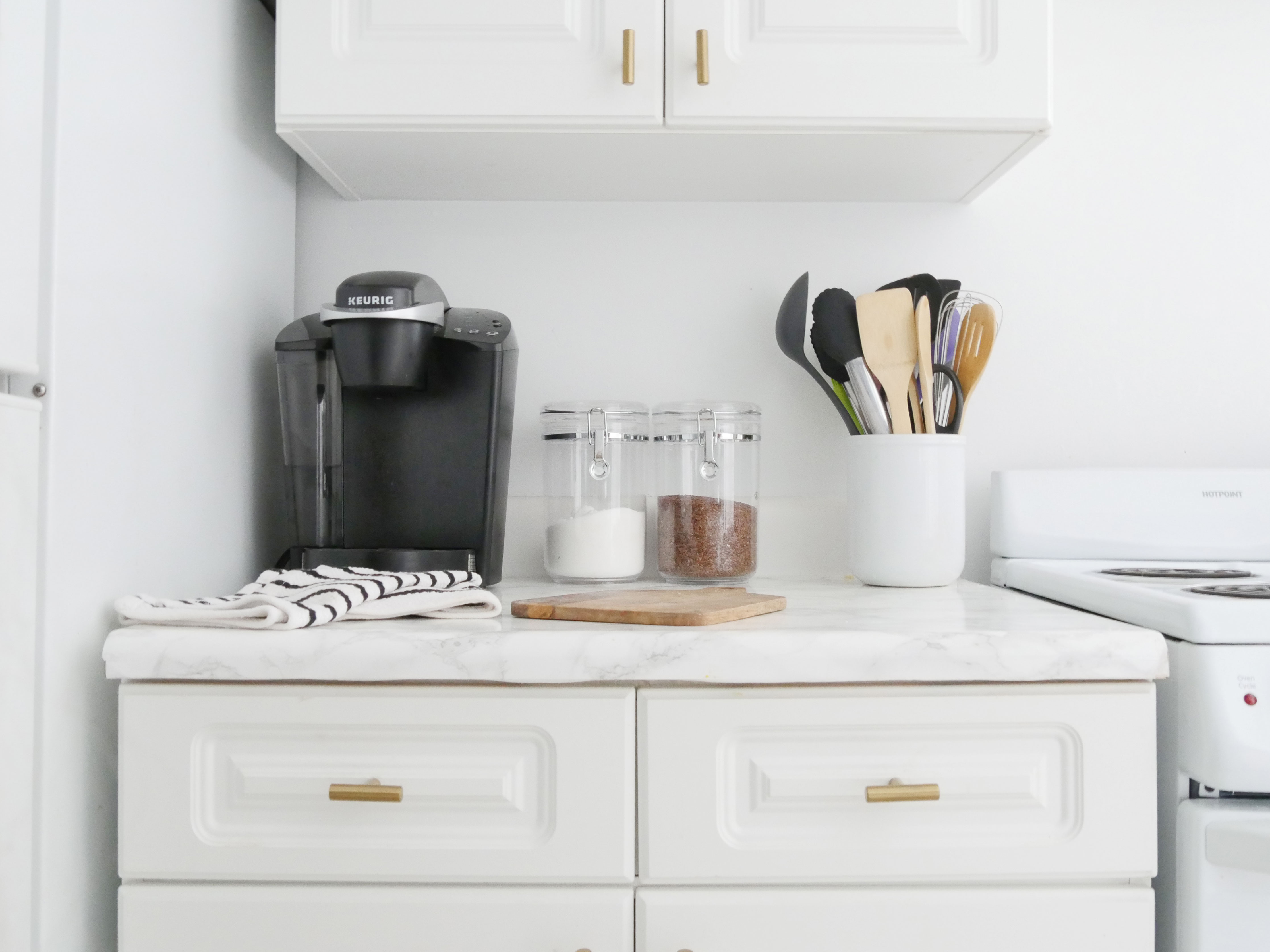 how to decorate your kitchen lights countertop city chic decor most people stick with the usual black appliances however switching it up can create a stunning visual impact i bought white keurig for my next