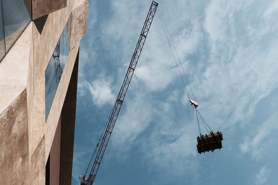 A construction crane lifting material for the Museum Tower Apartments.  The photo is used as a metaphor for the City Daily Photo improvements.