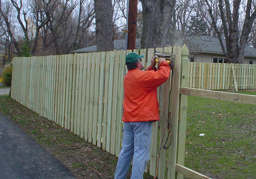 a picket fence being built
