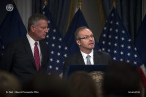 Mayor De Blasio and DOB Commissioner Chander at Bill signing.