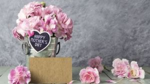 carnations in jar with sign saying happy mothers day