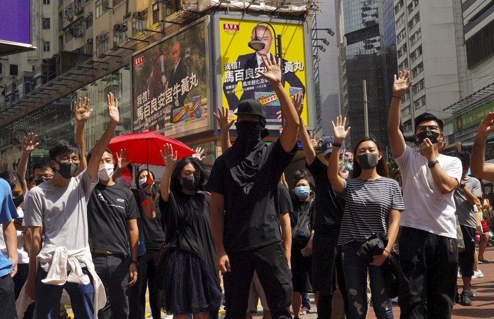 Thousands protest mask ban as Hong Kong leader toughens stance - NEWS 1130