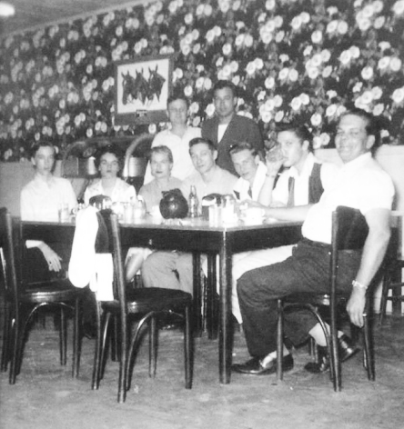 Gene Smith, Betty Amos, Helen (Neal) Hobgood, Scotty, Charles Neal, Elvis and Bob Neal with Jimmy Work and Bill Black standing in a cafe in Clarksdale, MS - Mar. 10, 195.5 (Photo source A. Fernándes).