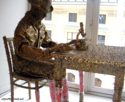 modern art made out of tin-tacks