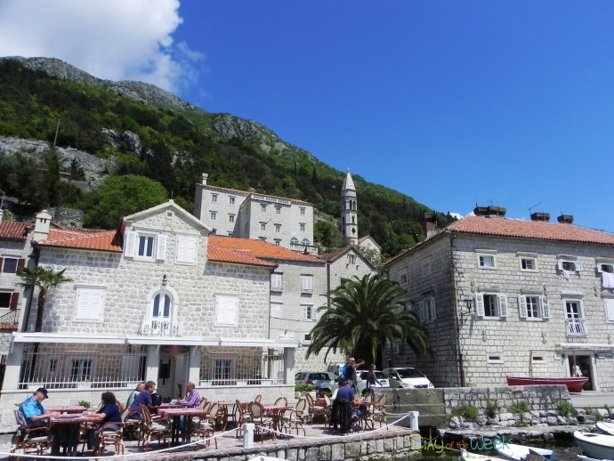 stone houses among green hills in Perastt