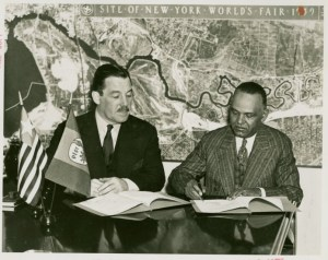 Grover Whalen signing a fair contract with a Liberian delegate circa 1938