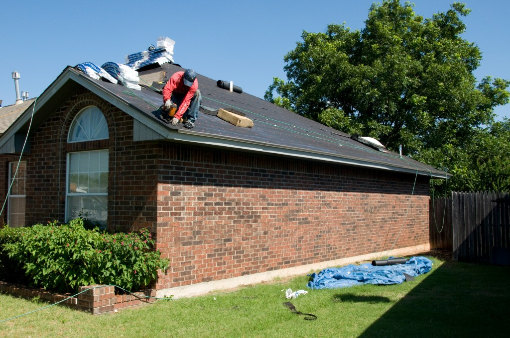 Roofer working on house