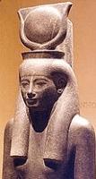 حتحور فى شكل أدمى تحمل قرص الشمس على رأسها