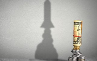 US-currency-stack-rocket-shadow