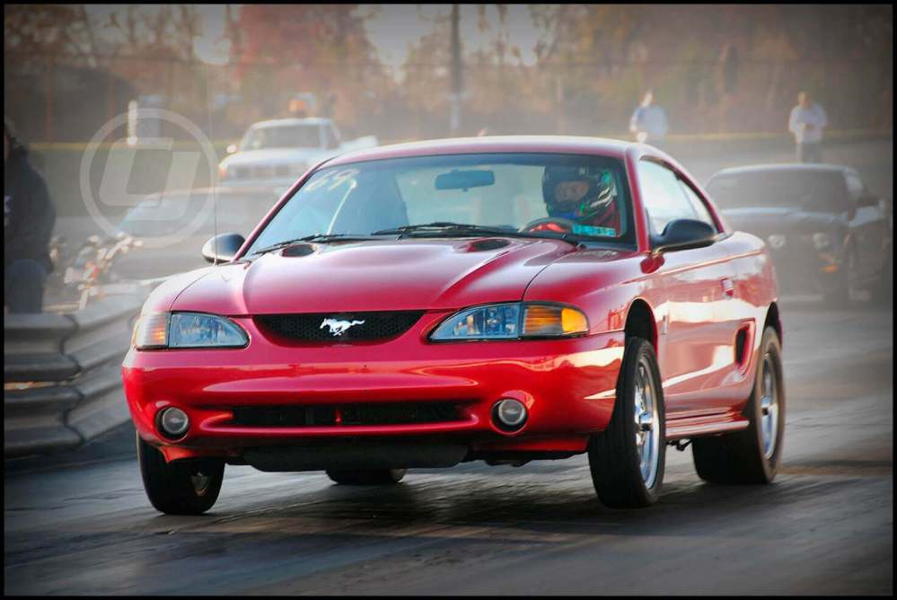 medium resolution of a well maintained red mustang