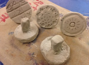 TN-completed clay stamp designs