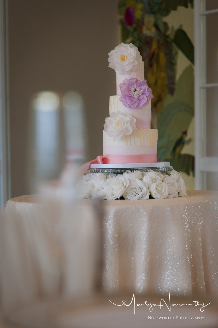 Watercolour wedding cake with drips and wafer paper flowers