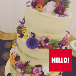 semi naked wedding cake with fresh, edible flowers