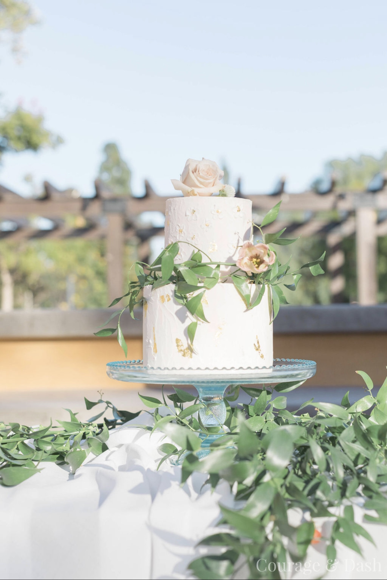 Peach royal icing cake with fresh flowers