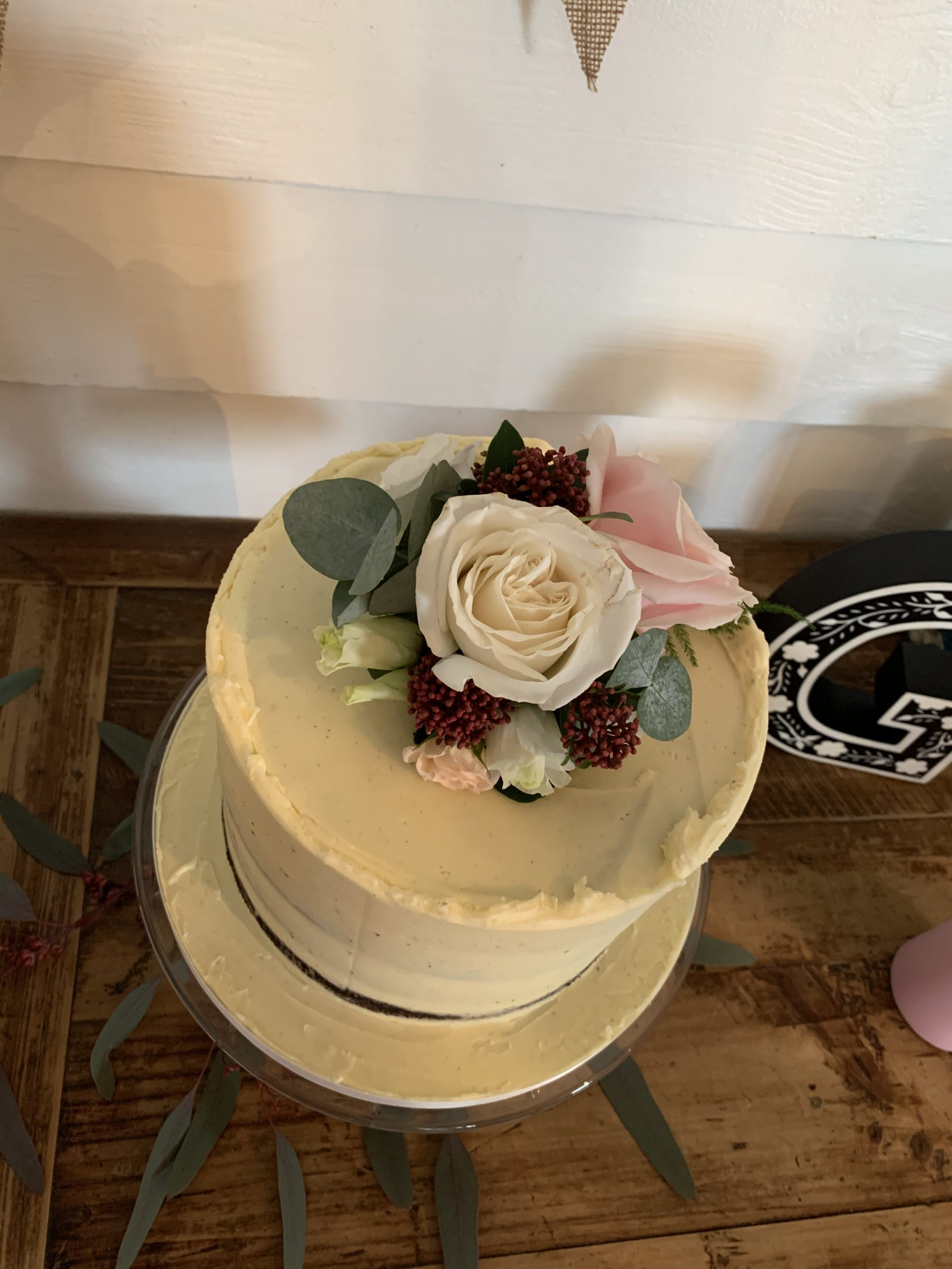 Rustic buttercream cake with fresh flowers