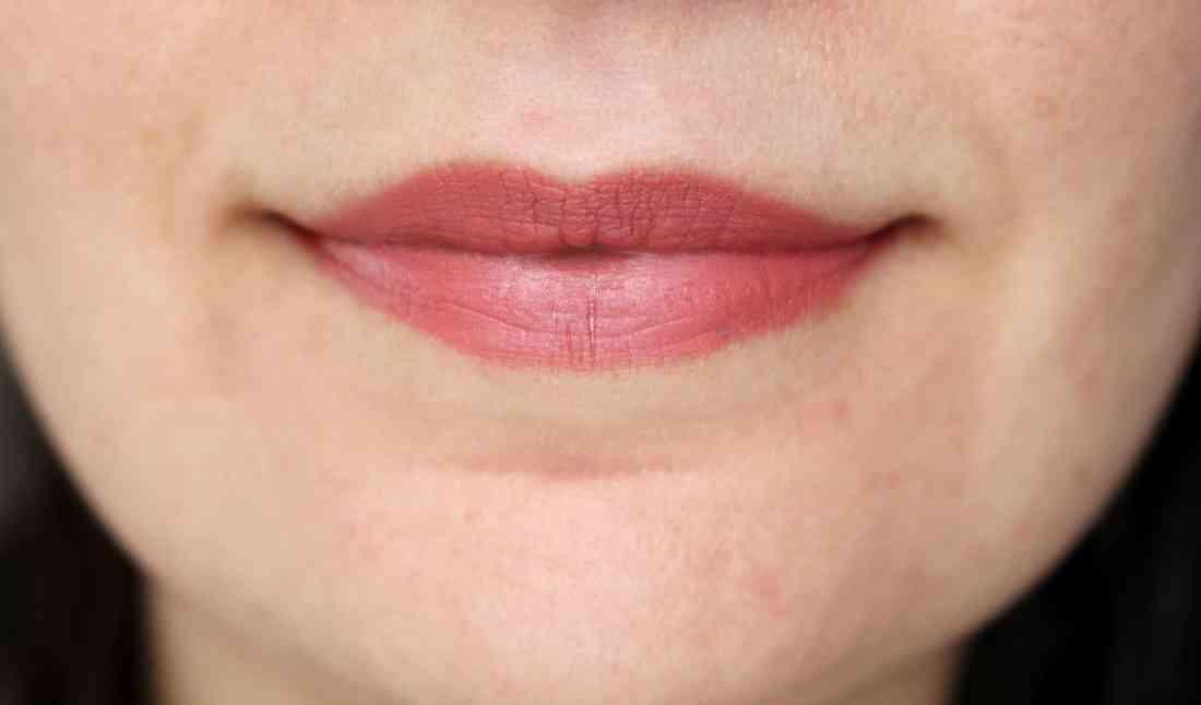 wearing Kat Von D studded kiss creme lipstick in og lolita