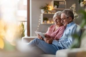 couple on the sofa looking at ipad