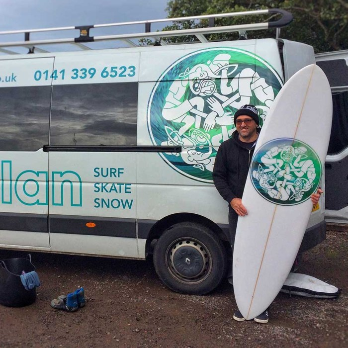Jamie Blair with custom surfboard