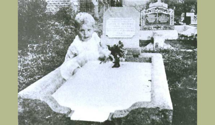 Ghost child at gravesite.