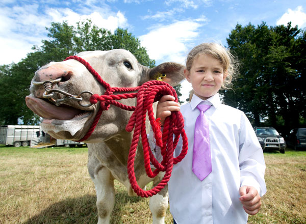 Seven-year-old Naoise Conlon, Inagh, has her hands full at Bridgetown Show on Sunday. Photograph by Arthur Ellis
