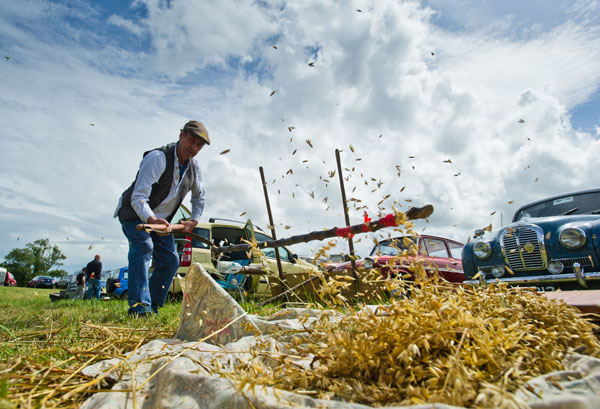 Michael McElligott of Pallasgreen threshing oats by hand at Kildysart Agricultural Show. Photograph by John Kelly.
