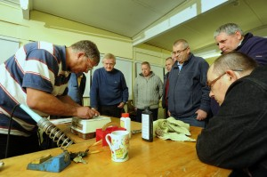 The lads gather round for a demonstration in soldering during the first tutorial with stained Glass tutor Gerry Ruane at the Sixmilebridge/Kilmurry Mens Shed. Photograph by John Kelly.