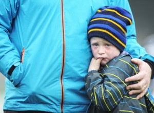 Young Sixmilebridge fan Fionn Hayes, son of selector Pat Hayes is clearly dissapointed with the club's defeat by Na Piarsaigh following the the Munster Club Championship final at Cusack park. Photograph by John Kelly.