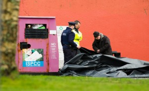 Priest, Fr Tom O Dea, at right with Gardai at the scene at Ballynacally where the body of a man in his sixties was discovered on Saturday morning. Photograph by John Kelly.