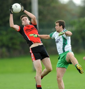 Gary Brennan, Clodegad demonstrates his high-fielding abilities in a club match. Photograph by John Kelly.