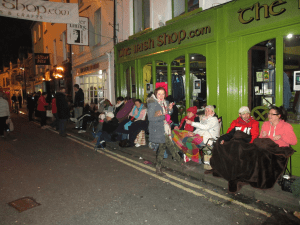 Die hard fans are still queuing outside the Irish Shop as they prepare for a long, cold night.