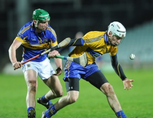 Conor Cleary of Clare in action against Conor Kenny of Tipperary during their Waterford Crystal Final at The Gaelic Grounds. Photograph by John Kelly.
