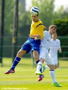 Colin Smyth of Clare League in action against Stuart Glynn of AUL Dublin during the Oscar Traynor Trophy Final at AUL Complex, Clonshaugh, Dublin. Photograph by John Kelly.