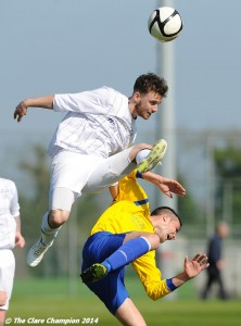 Conor Dillon of AUL Dublin in action against Stephen Kelly of Clare League during the Oscar Traynor Trophy Final at AUL Complex, Clonshaugh, Dublin. Photograph by John Kelly.