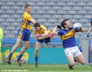 Martin Oige Murphy and Martin Mc Mahon of Clare in action against Barry Grogan of Tipperary during the Division 4 League final in Croke Park. Photograph by John Kelly.