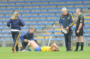 Eimear Considine of Clare is treated for an injury before being removed by stretcher during their Division 1 National League Camogie Final against Kilkenny in Thurles. Photograph by John Kelly.