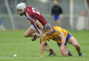 Clare's Domhnall O Donovan in action against Galway's Jason Flynn during  the challenge game as part of the Kilmurry Ibrickane GAA Club 100th anniversary celebrations. Photograph by John Kelly.