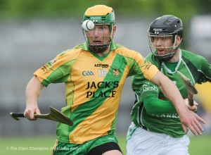 Conor Cooney of O Callaghan's Mills in action against Padraig Brody of Scariff during their game in Cusack Park.
