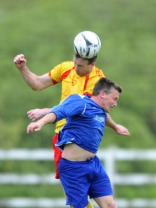 Avenue Utd's David Russell rises above Adrian Walsh. Photograph by Declan Monaghan