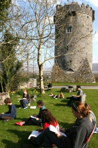 Students working in the shadow of Newtown Castle at the Burren College of Art.