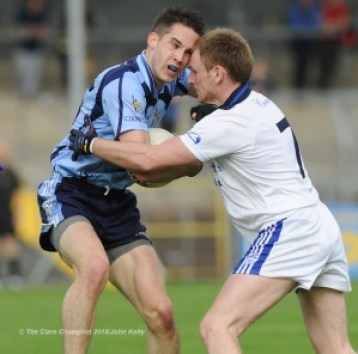 Cooraclare's  Cathal Lillis goes eye to eye with Cratloe's  Enda Boyce during their semi final at Cusack park. Photograph by John Kelly.