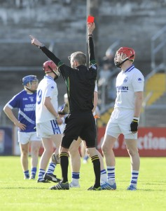 Denis Maher of Thurles Sarsfield's gets sent off by the referee Cathal Mc Allister early on during their Munster Club quarter final in Cusack park. Photograph by John Kelly.
