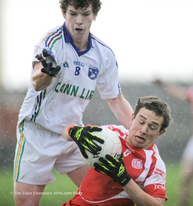 David Reidy of Eire Og in action against Jack O Dea of Clann Lir during the  U-21A final in Miltown Malbay. Photograph by John Kelly.