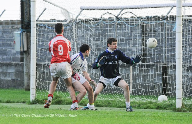 Dara Walsh of Eire Og scores a goal against David Mc Namara and John Fawl of Clann Lir during the  U-21A final in Miltown Malbay. Photograph by John Kelly.