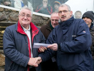 Cratloe 's John Ryan receives the winner's cheque from The Clare Champion's Liam Duggan.