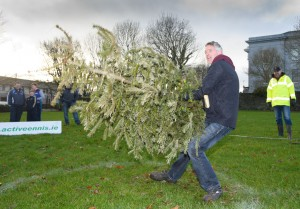 Tom Donnellan gives of his best during the annual Christmas tree throwing championships. Photograph by John Kelly.