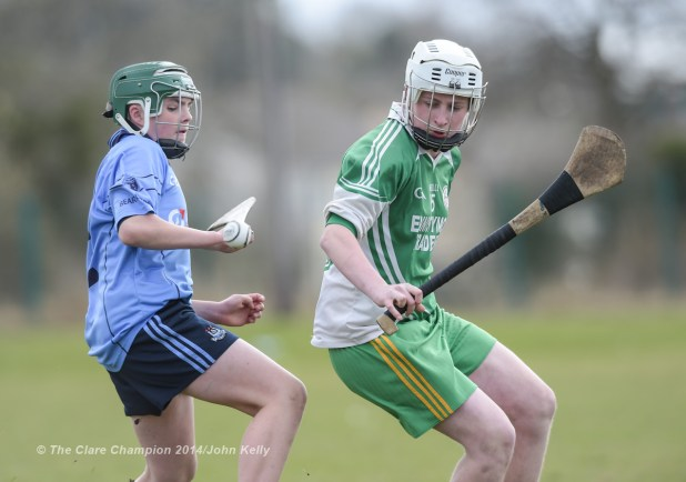 Patrick Ryan of Scariff Community College  in action against Jason Devereux of Ennistymon CBS during their Munster U-15 D final at Clarecastle. Photograph by John Kelly.