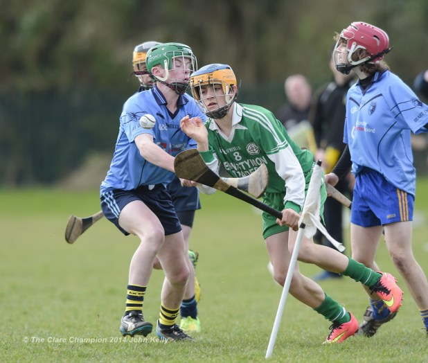 Henry Mc Grath of Scariff Community College  in action against Aidan Mc Carthy of Ennistymon CBS during their Munster U-15 D final at Clarecastle. Photograph by John Kelly.