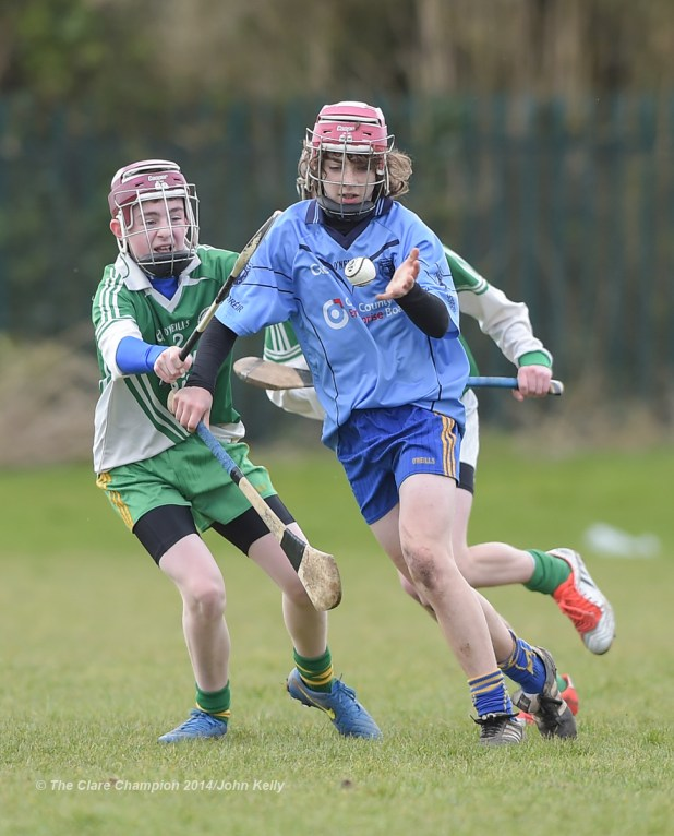 Fionn Slattery of Scariff Community College  in action against Dean Lynch of Ennistymon CBS during their Munster U-15 D final at Clarecastle. Photograph by John Kelly.