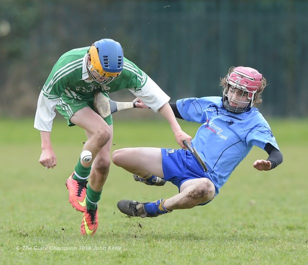 Aidan Mc Carthy of Ennistymon CBS in action against Aidan Sheedy of Scariff Community College during their Munster U-15 D final at Clarecastle. Photograph by John Kelly.